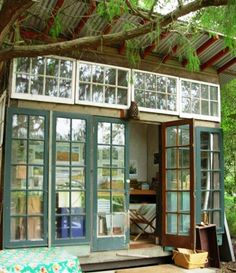 Jeff Shelton creates garden huts using reclaimed wood and vintage doors and windows. Via Remodelista