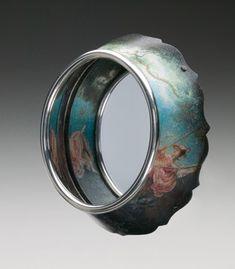 Diane Falkenhagen - 'Dalliance' brooch in sterling silver, mirror, and mixed media.