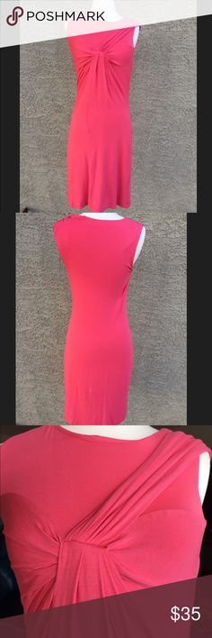 "Calvin Klein sleeveless knot top dress, size 4 Excellent condition Calvin Klein sleeveless knot top dress, size 4 in a pink/coral color. No stains or holes. Length of dress is 35"". Fully lined. Material is rayon and spandex. Calvin Klein Dresses Midi"