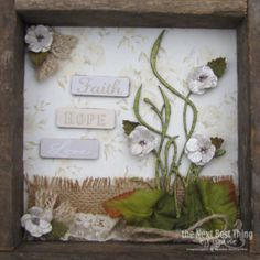 Faith Hope and Love ~  This is the fourth piece of an altered wood frame that features FAITH paper by Authentique and Petaloo flowers, trims and more by Lynne Forsythe.  Come to the Petaloo Blog and see all four pieces together!