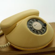vintage YELLOW rotary phone. you know, if I had a landline for it.