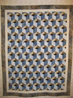 Tumbling blocks variation quilt by Jan Mott at Handiquilter