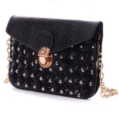 NWT Black studded leather crossbody bag Beautiful sparkly black envelope clutch with gold chain.  Product Dimensions: 4.53 x 7.28 x 0.3 inches; 0.53 lb,with 52.36 inch Drop-in Chain Shoulder Strap; Envelope style with magnetic snap closure. Open Method: Front Buckle Open Volume: Can hold a phone,a wallet,a cosmetic, etc. Bags Mini Bags