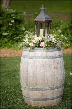 rustic wine barrel and vintage wood lantern wedding decor / http://www.himisspuff.com/rustic-country-wine-barrel-wedding-ideas/4/
