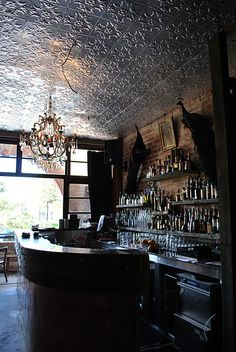 The Hunky Dory Social Club. What an eclectic mix of surfaces and fixtures! That pressed tin (?) ceiling is amazing.