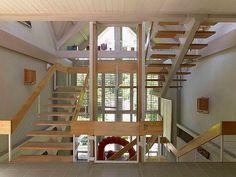 His Life's Work: Estate of Jack Lenor Larsen | The house's staircase. #design #interiordesign #interiordesignmagazine #architecture #wood #staircase