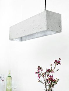 Raw Concrete Pendant Lamps Pouring Warmth and Elegance (via Bloglovin.com )