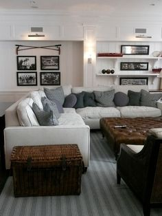 Comfortable family room with vintage sports theme. White wainscotting wall paneling,