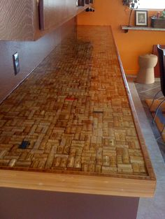 wine cork countertop...after sealing. So cool! #corks #counter #kitchen