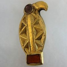 Meroving silver gilt brooch, with inlaid garnets in the shape of a bird. ca 450 A.D. The back is left silver and has similar brooch fitting as Roman brooches have.