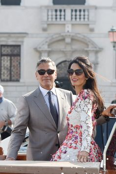 Amal Alamuddin arrives with husband, George Clooney in a floral lace dress.
