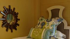 Pick Unusual Shapes - 23 Stylish Dorm Room Ideas - Southern Living - A statement-making headboard like this one adds a huge wow-factor to a small room. A fun print and monogrammed pillow finish off the look without needing tons of extra accessories.