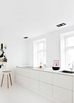 white kitchen clean lines space minimalist styling design windows white flooring, cabinetry and walls: