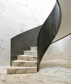 Renderings of Starck's interiors show the use of local materials including marble quarried from the Brazilian states of Paraná and Bahia. A twisting marble and Corten-steel staircase is depicted as it sweeps down onto the marble floor. Marble Staircase, Modern Staircase, Staircase Design, Staircase Ideas, Hotel Architecture, French Architecture, Philippe Starck, Foyers, Matarazzo