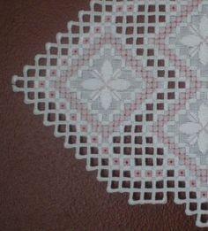 This precious uniquely shaped doily is done on white linen fabric with white…