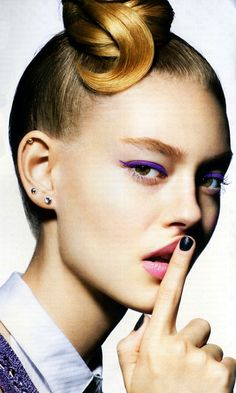 LE FASHION BLOG BEAUTY EDITORIAL TEEN VOGUE BRIGHT PURPLE EYE LINER BLACK NAILS TOP KNOT BUN MULTIPLE PIERCINGS STUDS