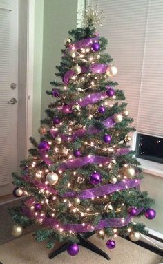 will try to change up my christmas tree this year with ribbon - Purple And Gold Christmas Tree Decorations