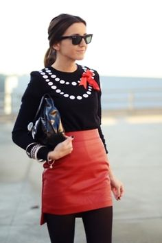 toughen up a sweet sweater with a red leather mini.