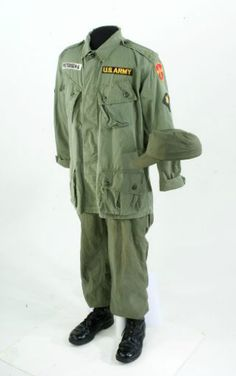 U.S. Army Fatigue Uniform during the Vietnam War.  Green cotton jacket with matching pants and cap. Jacket was worn by George Peterson.
