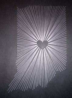 Indiana State String Art- white thread hand-stitched onto 10x10 black cardstock.  This took about three hours total: 1 hour to decided on spacing of holes/lines and then 2 hours to stitch.  Now I need to find a square frame to put this in :)