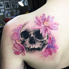 Chronic Ink Tattoo - Toronto Tattoo Custom Skull and water colour lotus flowers tattoo on the shoulder blade, done by Martin.
