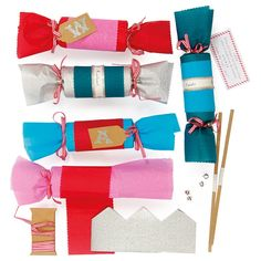 Make your own Christmas crackers with this set from Meri Meri. With enough supplies for 10 crackers, it includes cracker snaps, ha