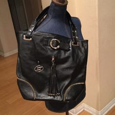 Purse Boutique black purse with tassel zipper pocket with gold tone hardware. used a had full of times Bags Satchels