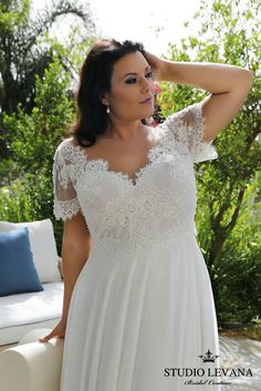 This boho plus size wedding gown from Studio Levana is born to flatter a fuller body. For a romantic bride who wants something a little different.