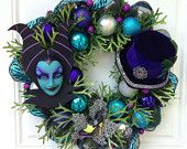 Maleficent Wreath from Sparkleforyourcastle on Etsy...Featuring Beautiful Maleficent Mask from PiratesQuarters on Etsy.com - https://www.etsy.com/listing/71504756/maleficent-mask-evil-queen-sleeping?ref=shop_home_feat