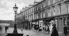 Old photograph of shops, people and houses on Alexander Street in Clydebank by Glasgow , Scotland . All photographs are copyright of Sa. Scotland Kilt, Glasgow Scotland, Family History Book, Old Trees, Old Photographs, Container Flowers, Scandinavian Christmas, Paths, National Parks