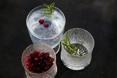 Finnish Gin tonic serving suggestion with a sprig of rosemary and cranberries. Cocktails, Drinks, Gin And Tonic, Distillery, Food And Drink, Eat, Cooking, How To Make, Cranberries