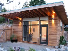 Eco-shed-sustainably designed; 280 sq. ft; features a fully functional, kitchen and bathroom as well as a large living quarters; many people build in their backyard as a work space, studio, or separate residence.