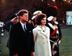 November 13, 1963: Jack and Jackie on the White House lawn, during the opening ceremonies for the Black Watch performance.