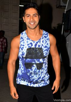 Varun Dhawan shows off his buff body in a tight sleeveless vest. via Voompla.com