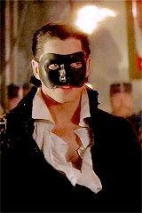 Erik(Phantom,I don't know his last name) from The Phantom of the Opera(2004) <3333  *whips cape aggressively* < *walks closer to Christine,Christine turns her face away and looks up at Raoul* *BOTH ERIK AND CHRISTINE START TO SING AND WALK UP THE STAIRS, THEN ERIK SINGS THE SONG THAT RAOUL AND CHRISTINE SUNG TOGETHER ON THE ROOF THEN HE PUTS HIS HAND ON HER NECK AND PUTS HIS FACE NEAR HER HAIR* *CHRISTINE LOOKS AT HIM AND TAKES OFF HIS MASK*-I should stop now - The wolf that kills