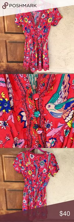"""Lovebird Mini Sundress ✨NWOT✨ Super adorable flowy coral mini sundress with colorful birds & botanical print by Austin Gal Boutique. Has short sleeves, elastic stretch waistband & low v-neck with button-down bodice. Size L, fits true to size. Bust: 38"""", Waist: 24-40"""" & Length: 35"""". Non-stretch, 100% polyester. This is a re-Posh however it's never been worn & there's no flaws. Perfect for summer beach days! 🌞 Price is firm. 👍 15% off 3+ item bundles! Austin Gal Dresses Mini"""