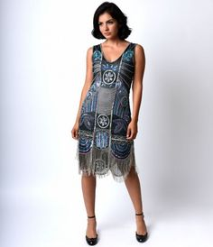 Get ready for an evening of cocktails and jazz in an outfit that epitomizes the romance of the 1920s. Unique Vintage's...Price - $340.00-TPdnTBNk
