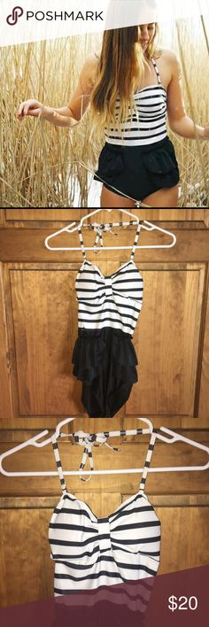 Black and white striped one piece swim suit! Great condition! Worn twice. Check out my other listings! Bundle and save:) Swim One Pieces