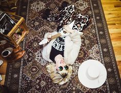 Get this look: http://lb.nu/look/7957060  More looks by Rachel Lynch: http://lb.nu/ihateblonde  Items in this look:  Show Me Your Mu Mu Leopard Bell Bottoms, Unif White Fur Jacket, Gypsy Warrior  Grateful Dead Tee, Zero Uv Round Rainbow Sunnies, Nasty Gal White Cowgirl Hat   #bohemian #grunge #rock n roll #ihateblonde