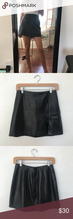 Vintage black leather mini skirt Small side slit. Zips up the back. Real leather! Skirts Mini