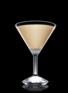 Snickers Martini -  4 Parts ABSOLUT VODKA, 2 Parts Hazelnut Liqueur, 2 Parts White Cacao Liqueur, 1 Part Cream Liqueur. Garnish with Snickers mini.  Another way to use up that Halloween candy.