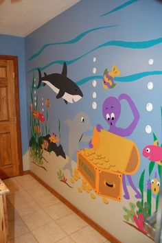 Sea Treasures Wall Mural : Just tape, trace & paint this easy, DIY paint-by-number wall mural that features underwater adventure with a dolphin, shark and octopus with a sunken treasure. Decoration Creche, Decoration Table, Decorations, School Murals, Under The Sea Theme, Church Nursery, Colorful Fish, Tropical Fish, Ocean Themes