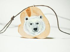 Polar bear face. Unique hand painted wooden art jewelry  #jewelry #bear #teddy #jewelry #woodjewelry #wood #pendant #handpainted #painted #artjewelry #finland #art #animal #jewelry #diy #polar #bear #polarbear