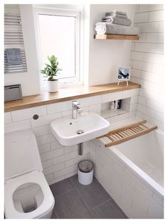 Bathroom:Wooden Wall Rack Glass Window Toilet Seat Ceramic Sink Modern Steel Faucet Trash Can Ceramic Bathtub Three Crucial Aspects in Upgrading Small Bathrooms