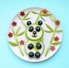 Fun food: fruit panda and bamboo from green apples and blueberries