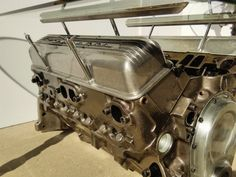 Check out this item in my Etsy shop https://www.etsy.com/listing/229017552/sbc-engine-table-with-script-finned Car parts man cave automotive decor gear head engine coffee table