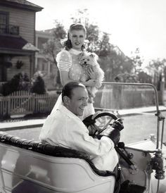 """freddie-my-love: """"A great shot of Fred and Ginger (with doggie) while filming The Story of Vernon and Irene Castle, 1939 """""""