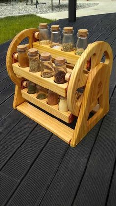 Like the idea of a spice carousel but prefer darker wood  test tunes like an apothecary.