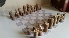 Carved tree branch chess set