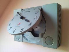Recycled wall clock from retro Sony PlayStation video game. It was their first console, childhood closed in time. Handmade wall clock by Creative Funny. Old Game Consoles, Playstation Consoles, Ps3, Handmade Wall Clocks, Retro Video Games, Old Games, Video Game Console, Light Up, Sony